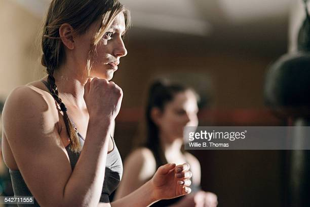 Woman Boxer training with punching bag