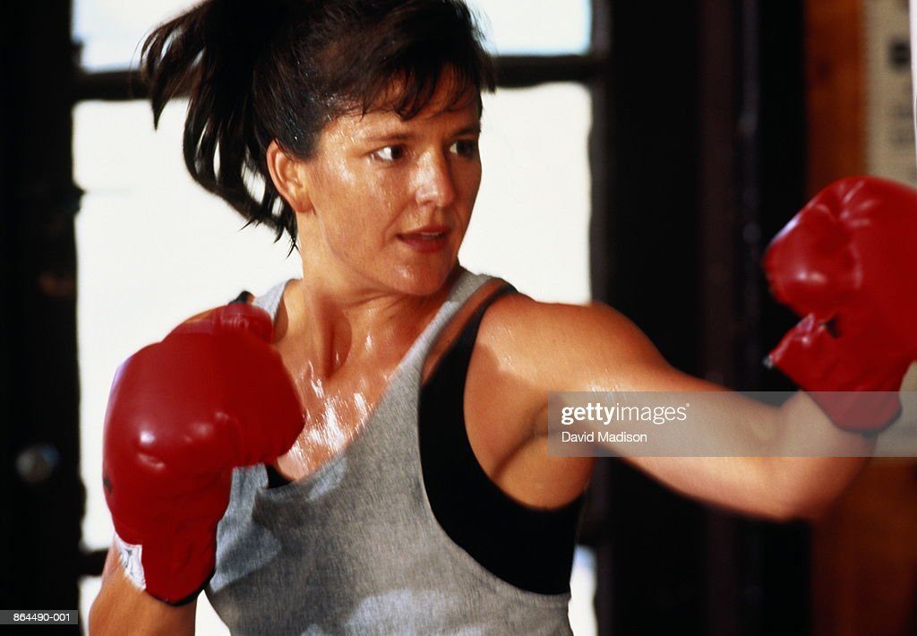 Woman boxing in gym : Stock Photo
