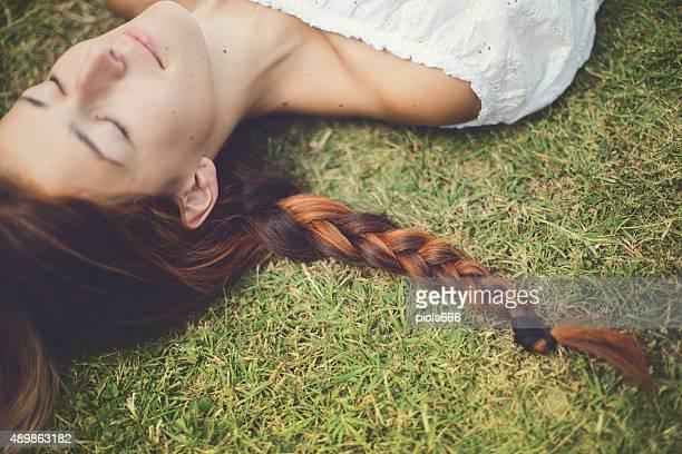 Woman, braid, grass and dreams