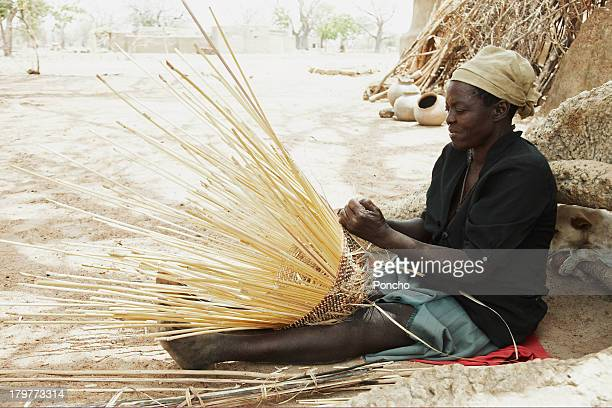 woman braiding a basket