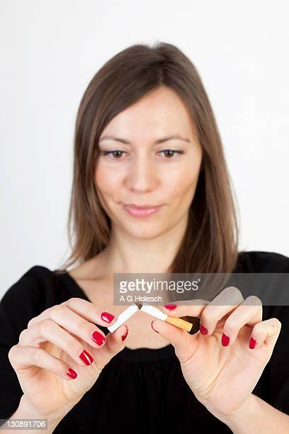 Woman breaking a cigarette