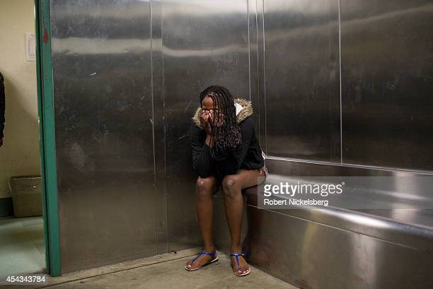 A woman breaks down after being searched in a holding room February 2 2013 by vice squad police with the Los Angeles Police Department of South...