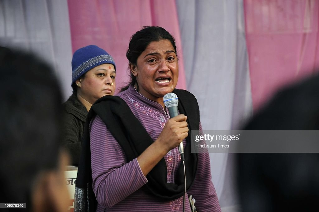 A woman breaks down as she recounts the horror she went through when she was raped by an IPS officer in Punjab in 2006, during the protest against the alleged inaction by the Indian government regarding the gang rape of a 23-years old student in a bus a month ago, on January 16, 2013 in New Delhi, India. The bus rape has drawn protests and intense media attention. Rapes have become front-page news nearly every day across the country, with demands that police do more to protect women and that the courts treat sexual violence seriously.
