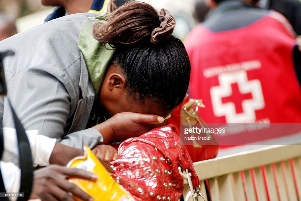 A woman breaks down in tears on September 24, 2013 at Oshwal Centre in Nairobi, Kenya after a fruitless search for her husband in hospitals and mortuaries. Her husband worked for Nakumatt supermarket at Westgate Mall. The terrorist attack occurred on Saturday, 10-15 gunmen from the extremist group Al-Shabab entered the mall and opened fire at random on shoppers; 68 deaths have been confirmed.