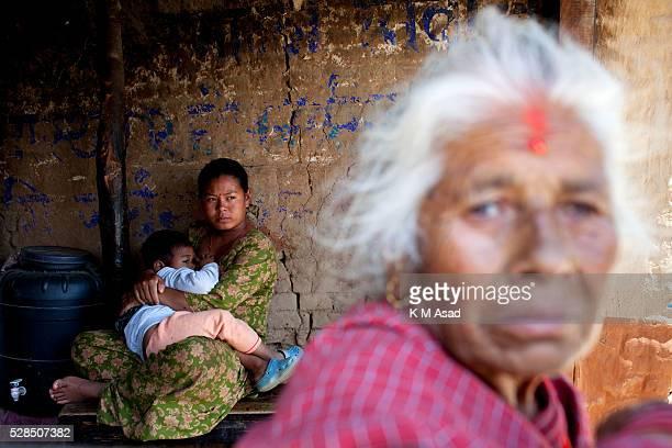 KATHMANDU BAKTOPUR KATHMANDU NEPAL A woman breast feeds her baby after a massive earthquake magnitude78 hit the country In Kathmandu Nepal May 01...