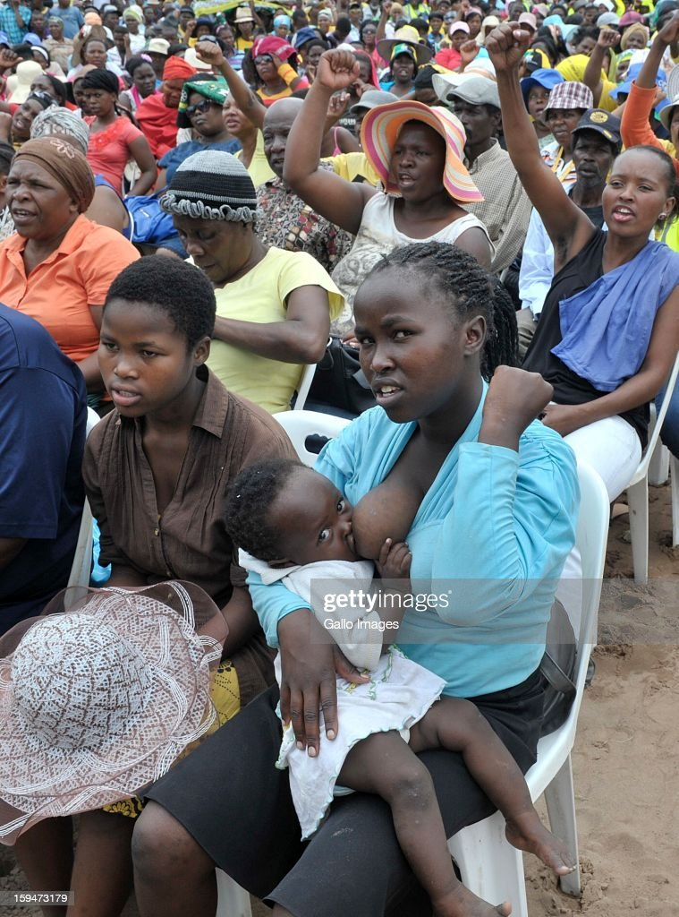 A woman breastfeeds her baby at the ANC rally on January 10, 2013, in Pietermaritzburg, South Africa. The ANC rally marked the party's 101 year of existence.
