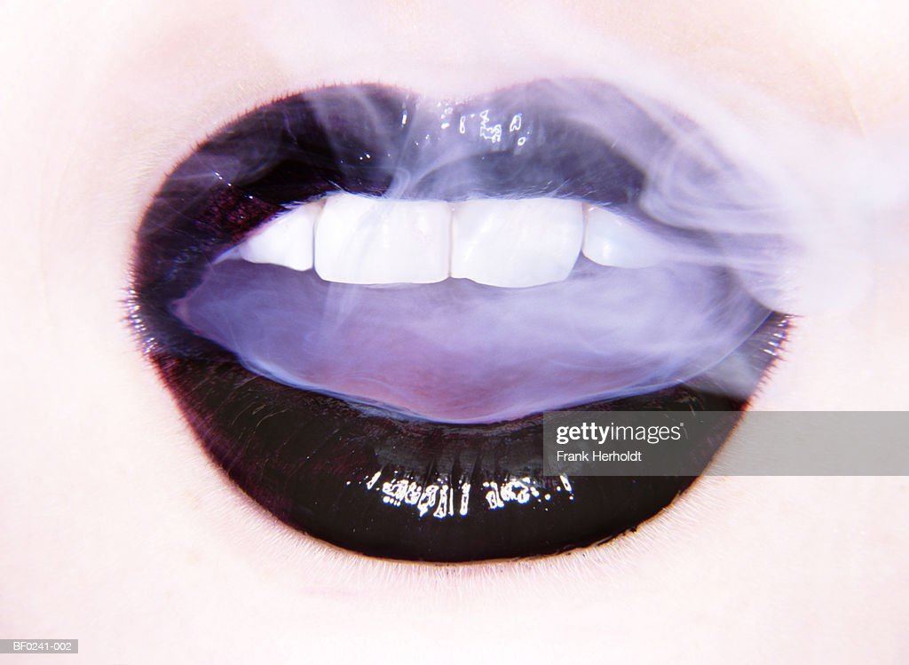 Woman breathing smoke, close-up (digital enhancement) : Stock Photo