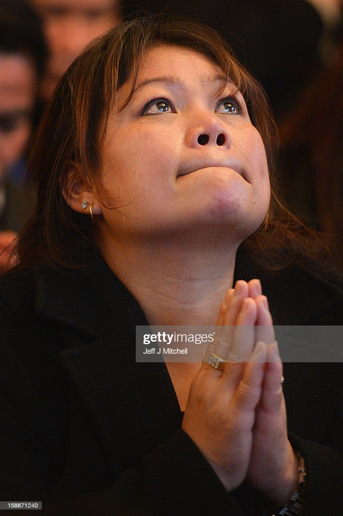 A woman brings her hands together in prayer at a service of remembrance for three thai Buddhist Monks who died in a car crash on Christmas Eve, at Oakvale Funeral Home on January 2, 2013 in Edinburgh, Scotland. Abbot Phramaha Pranom Thongphaiboon, 43, head of the Thai Buddhist community in Aberdeen, was killed in a car crash on Christmas Eve along with his colleagues Phramaha Kriangkrai Khamsamrong, 35, and Phramaha Chai Boonma, 36. The three men were travelling to the Dhammapadipa Temple in Edinburgh when they were involved in the head-on collision on the A68 near Pathhead, Midlothian.