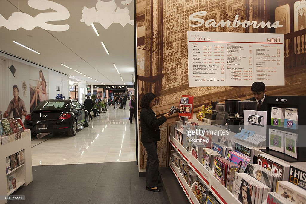 A woman browses a magazine inside a Grupo Sanborns SAB store in the Plaza Carso development in Mexico City, Mexico, on Friday, Feb. 8, 2013. Grupo Sanborns SAB, the retailer controlled by Mexican billionaire Carlos Slim, raised 10.5 billion pesos ($825 million) in an initial public offering (IPO) last week and the total could climb to 12.1 billion pesos including an overallotment option for underwriters. Photographer: Susana Gonzalez/Bloomberg via Getty Images