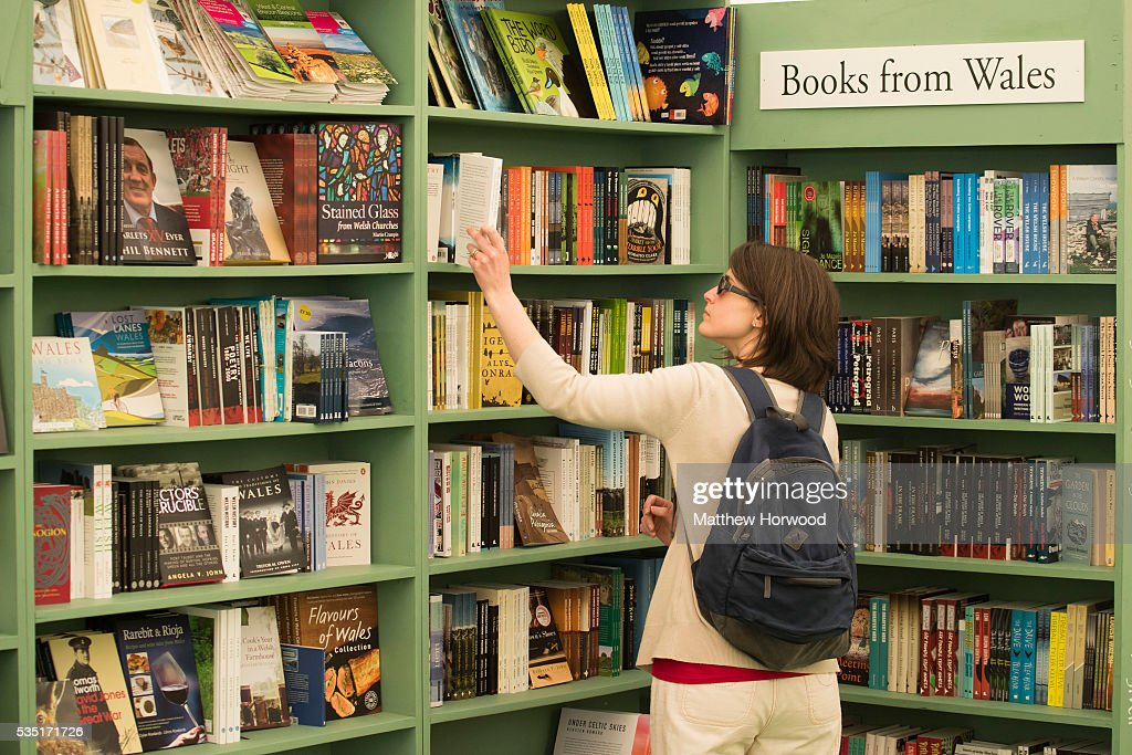 A woman browses books in a bookshop during the 2016 Hay Festival on May 29, 2016 in Hay-on-Wye, Wales. The Hay Festival is an annual festival of literature and arts now in its 29th year.