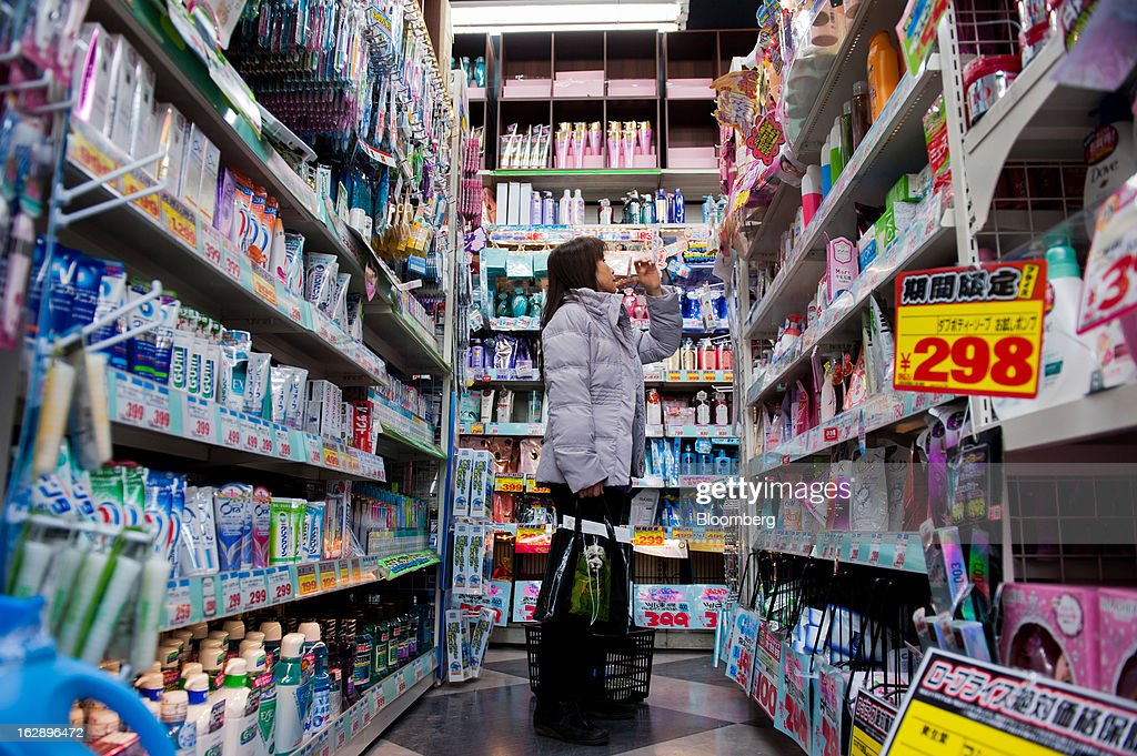 A woman browses products on a shelf in a discount store in the area of Shibuya in Tokyo, Japan, on Friday, March 1, 2013. Japan's consumer prices fell for the eighth time in nine months, highlighting the challenges facing the Bank of Japan in reaching a 2 percent inflation target. Photographer: Noriko Hayashi/Bloomberg via Getty Images