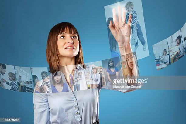 Woman browsing a futuristic photo library