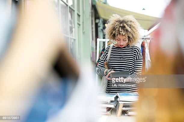 Woman browsing books at street market