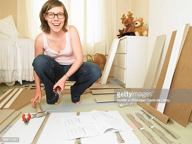 Woman building chest of drawers