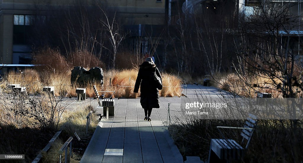 A woman bundled up against the cold walk through the High Line park in Manhattan on January 24, 2013 in New York City. Polar air settled in over the northwest U.S. Wednesday, with temperatures in the teens and twenties.