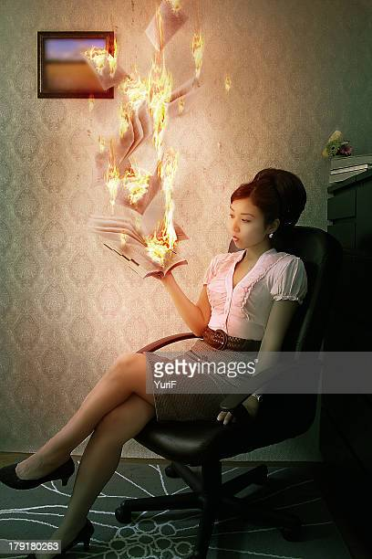 Woman burning a book with magic