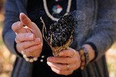 Woman smudging with sage