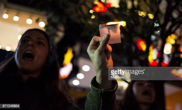 A woman burs a Ballot paper on April 20 2017 in Istanbul Turkey during the protesters march in opposition to perceived voting irregularities in...