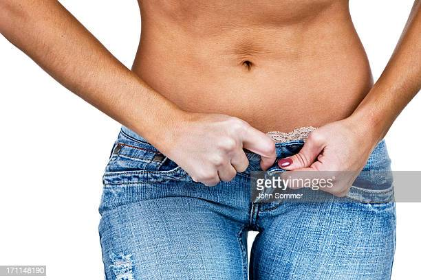 Woman buttoning or unbuttoning her pants