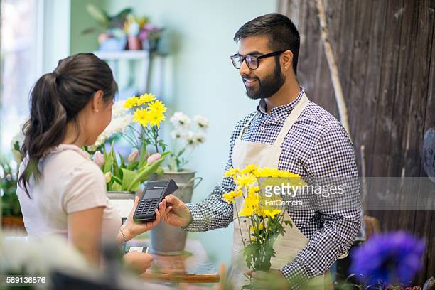 Woman Buying a Bouquet of Flower