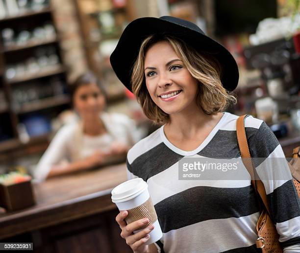 Woman buying a coffee to go