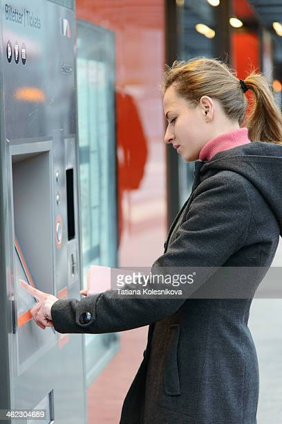 Woman buying a ticket for commuter