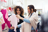 Woman buying baby sleep suit