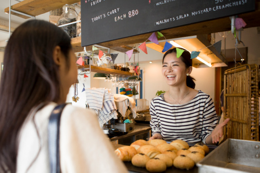Woman buying bread at counter