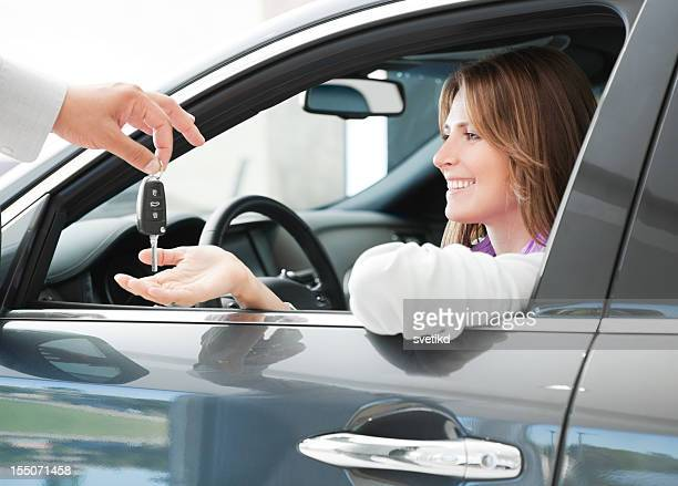 Woman buying car.