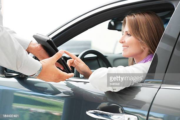 Woman buying car.
