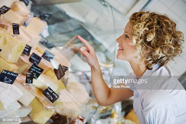 A woman buying cheese Sweden.