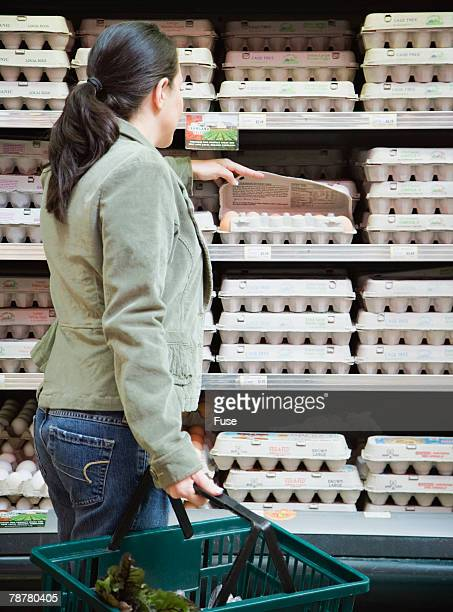 Woman Buying Eggs at Health Food Store