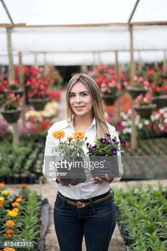 Woman buying flowers at a garden center