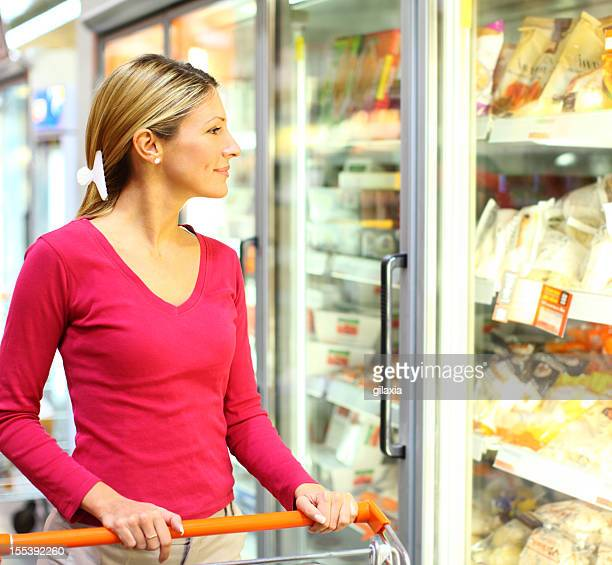Woman buying food in local supermarket.