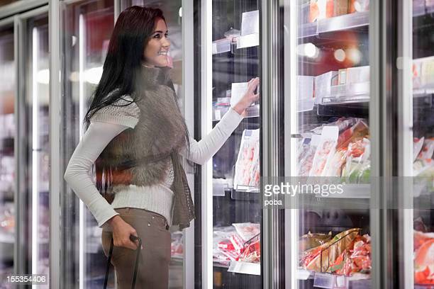 woman buying frozen food in supermarket
