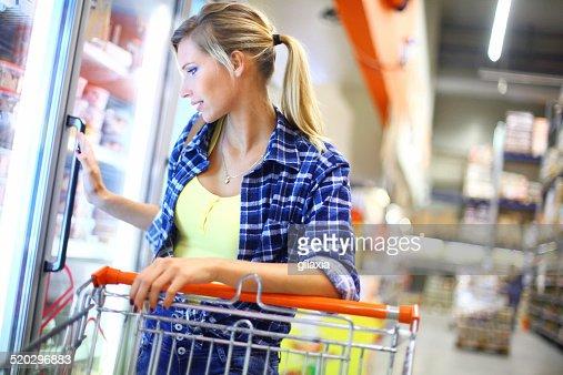Woman buying frozen food.