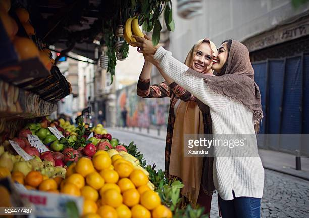 Woman buying fruits from the street vendor
