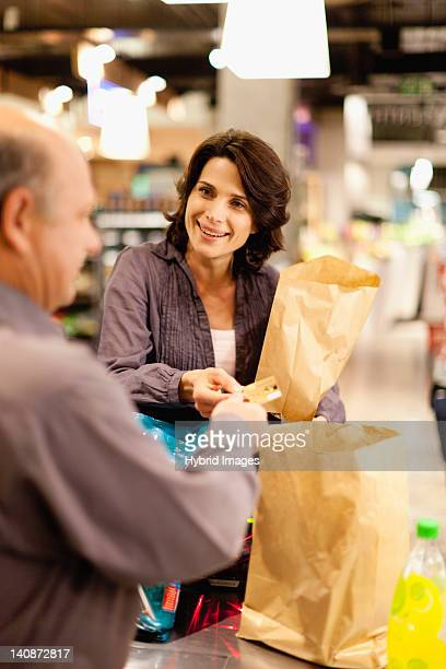 Woman buying groceries with credit card