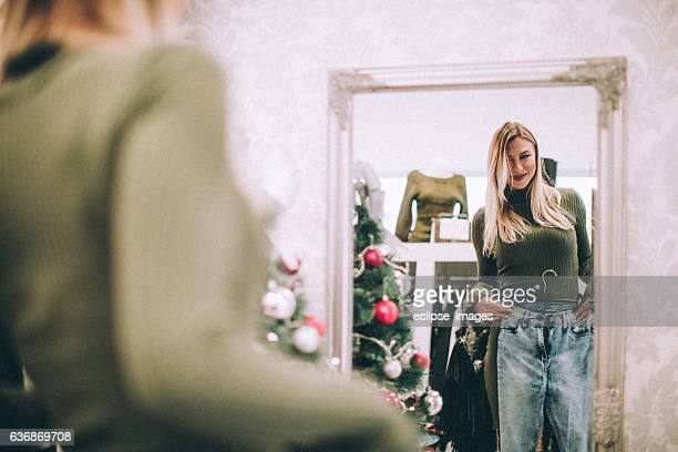 Woman buying jeans at retail store