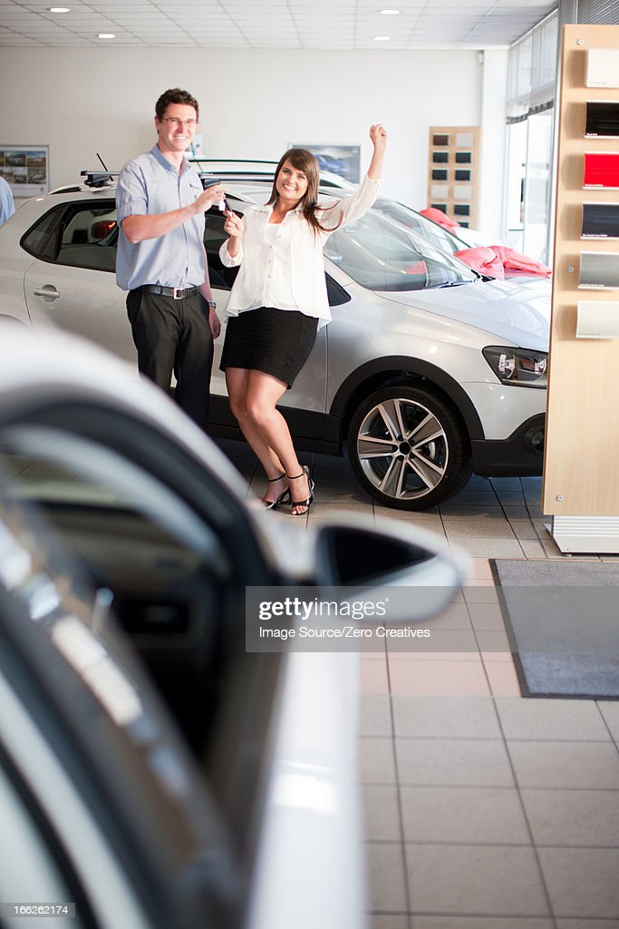 woman buying new car from salesman stock photo getty images. Black Bedroom Furniture Sets. Home Design Ideas