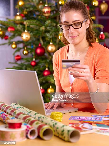 woman buying online with credit card at christmas
