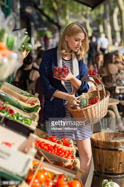 Woman buying organic produce at store