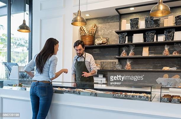 Woman buying pastries at a bakery