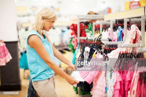 Woman buying pink dress.