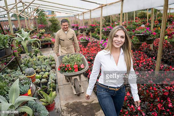 Woman buying plants at a graden center