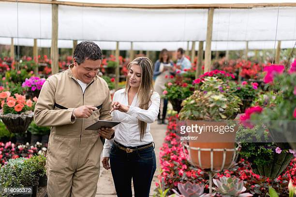 Woman buying plants at the greenhouse