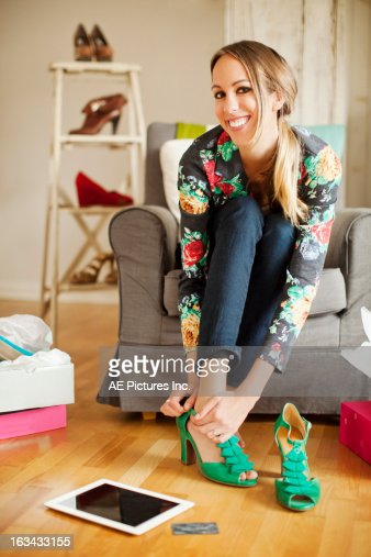 Woman buying shoes online : Stock Photo