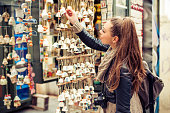 Young woman buying souvenirs in gift shop