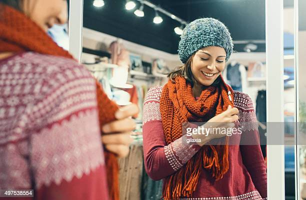 Woman buying winter clothes.