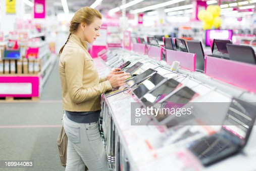 Woman buys a digital tablet at store